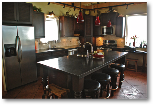 Kitchen with high end appliances, bar stools and everything you need for making and enjoying your meals